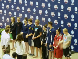 18-and-under national champions receiving their awards  from left to right: Katie Ledecky (mile), Liam Egan (Mile), Missy Franklin (200 backstroke & 100 free), Brian Murphy (200 back), Paul Powers (100 free), Andrea Cottrell (200 breast), Ilya Evdokimov (200 breast), Remedy Rule (200 fly) and Andrew Seliskar (200 fly).